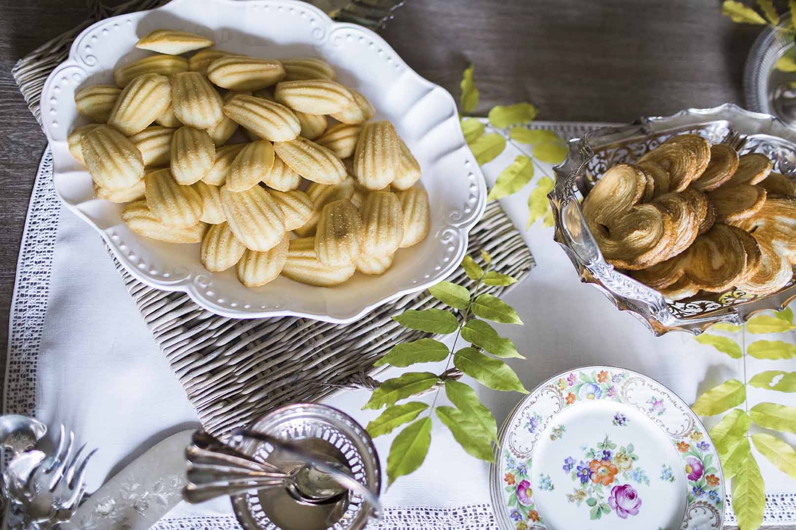table setting with artisan food and antique silverware