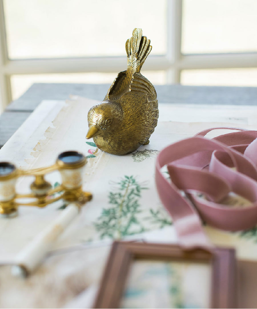 antique brass bird on tabletop